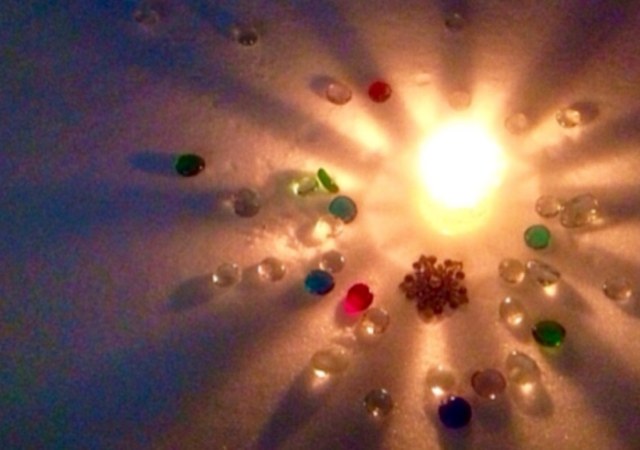 Candle and Gems in the Snow